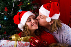 Young happy couple near a Christmas tree Stock Images
