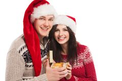 Young happy couple near a Christmas tree. Royalty Free Stock Photo