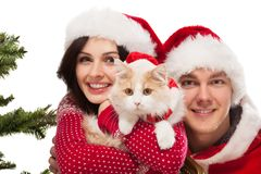 Young happy couple near a Christmas tree. Stock Photos