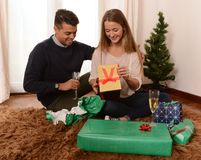 Young Happy Couple opening Xmas presents Royalty Free Stock Photography