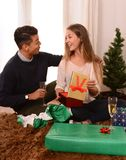 Young Happy Couple opening Xmas presents Royalty Free Stock Photo