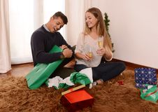 Young Happy Couple opening Xmas presents Stock Photo