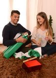 Young Happy Couple opening Xmas presents Stock Photos