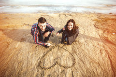 Young happy couple outdoor on the beach. Pretty young couple have fun on the beach Royalty Free Stock Photography