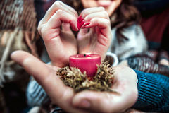 Young happy couple outdoor holding candle. Pretty young couple outdoor holding candle Stock Photo