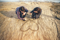 Young happy couple outdoor in the park. Pretty young couple have fun on the beach Stock Images