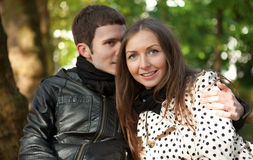 Young happy couple outdoors. At fall stock photography