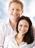 Young happy couple over a blue background Stock Photos