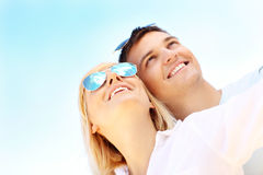 Young happy couple over blue sky Royalty Free Stock Photo