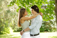 Young happy couple in the park Royalty Free Stock Image