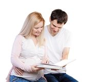 Young happy couple with photo album Stock Image
