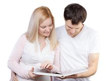 Young happy couple with photo album Royalty Free Stock Image
