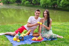 Young happy couple picnicking outdoors near the Stock Images