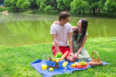 Young happy couple picnicking and relaxing Stock Image