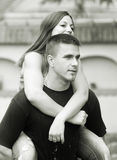Young happy couple piggy back riding outdoor Royalty Free Stock Photography