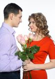 Young happy couple with pink roses Royalty Free Stock Photo