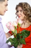 Young happy couple with pink roses Stock Images