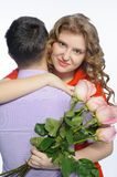 Young happy couple with pink roses Stock Photo