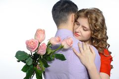 Young happy couple with pink roses Stock Photos