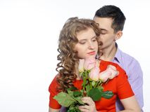 Young happy couple with pink roses Royalty Free Stock Image
