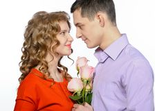 Young happy couple with pink roses Royalty Free Stock Photos
