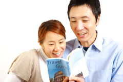 Young happy couple planning a travel  Stock Photos