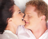 A young and happy couple playing together Stock Photography