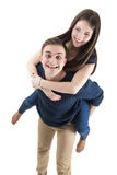 Young happy couple playing together piggyback Stock Image