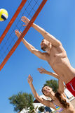 Young happy  couple playing volleyball Royalty Free Stock Image