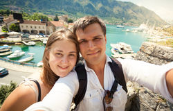 Young happy couple posing against sea bay at sunny day Royalty Free Stock Photography