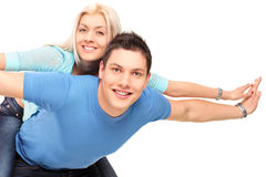 Young happy couple posing piggyback Royalty Free Stock Photography