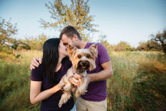 Young happy couple posing with their dog Stock Photos