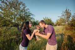 Young happy couple posing with their dog Stock Photo