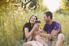 Young happy couple posing with their dog Stock Photography