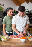 Young happy couple preparing lunch Stock Photography