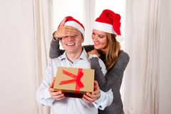 Young Happy Couple with Presents on rug at Christmas Stock Photos