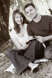Young happy couple reading a book Royalty Free Stock Image