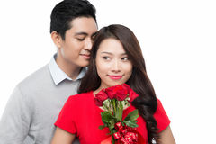 Young happy couple with red roses Stock Images
