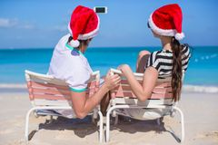 Young happy couple in red Santa hats taking a Royalty Free Stock Photography