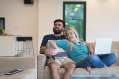 Young happy couple relaxes in the living room Royalty Free Stock Image