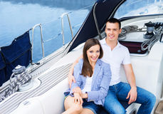 A young and happy couple relaxing on a boat Stock Photo