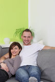Young, happy couple relaxing at home. Stock Image