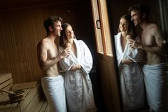 Young happy couple relaxing inside a sauna at spa resort hotel luxury royalty free stock photos