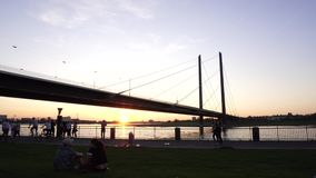 Young Happy Couple Rest on Rhine River Bank Sunset, Dusseldorf, Germany stock video