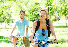 Young happy couple riding a bicycle Royalty Free Stock Images
