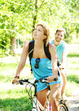Young happy couple riding a bicycle Stock Image