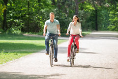 Couple Riding Bicycle stock photos