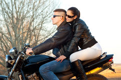 Young happy couple riding a motorcycle Royalty Free Stock Image