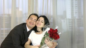 Young happy couple romantic date, celebrating valentine day man give red roses to his wife.  stock video footage