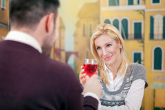 Young happy couple romantic date drink glass of red wine at rest Stock Photography